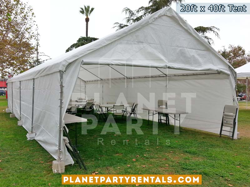 "20x40 White Party Tent on grass with 60"" Rectangular Tables and White Plastic Chairs"