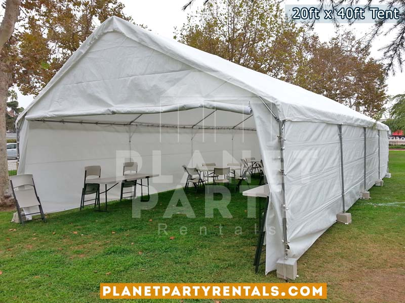 "20x40 White Party Tent on grass with 60"" Rectangular Tables and White Plastic Chairs20x40 White Party Tent on grass with 60"" Rectangular Tables and White Plastic Chairs"