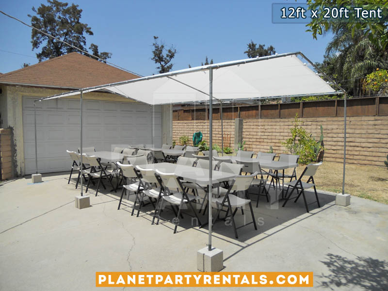 12 feet by 12 feet white Tent with tables and chairs | 12x20ft Does not includes walls only includes roof. Walls are not included with the tent rental | San Fernando Valley Tent Rentals