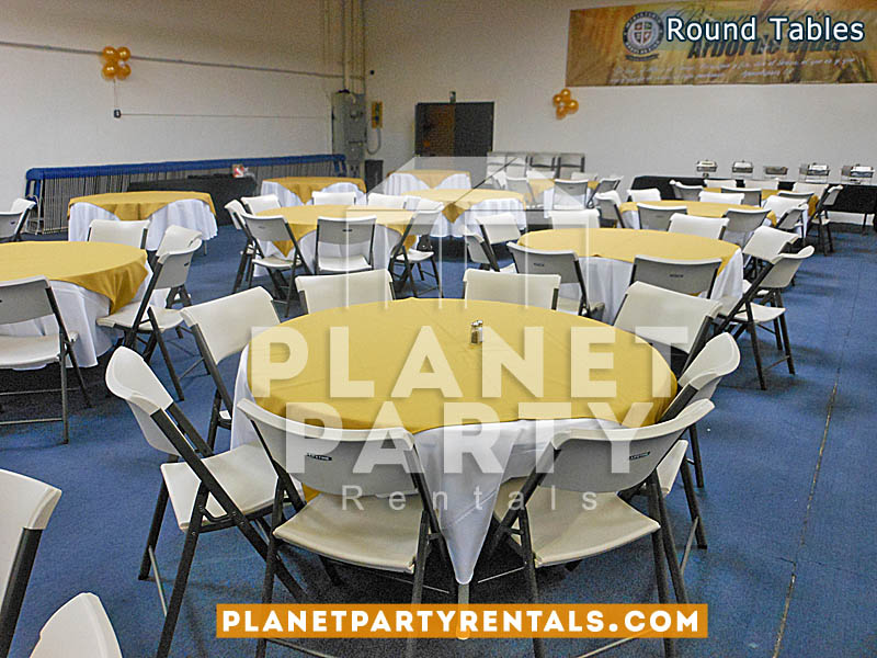 White Plastic Round Tables with White Round Tablecloths and Yellow Overlay
