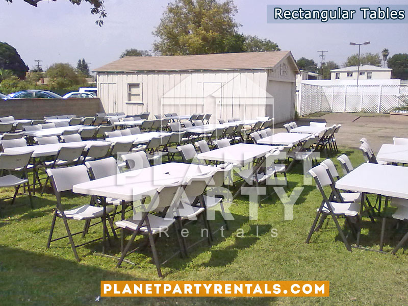 White Rectangular Tables with White Plastic Chairs