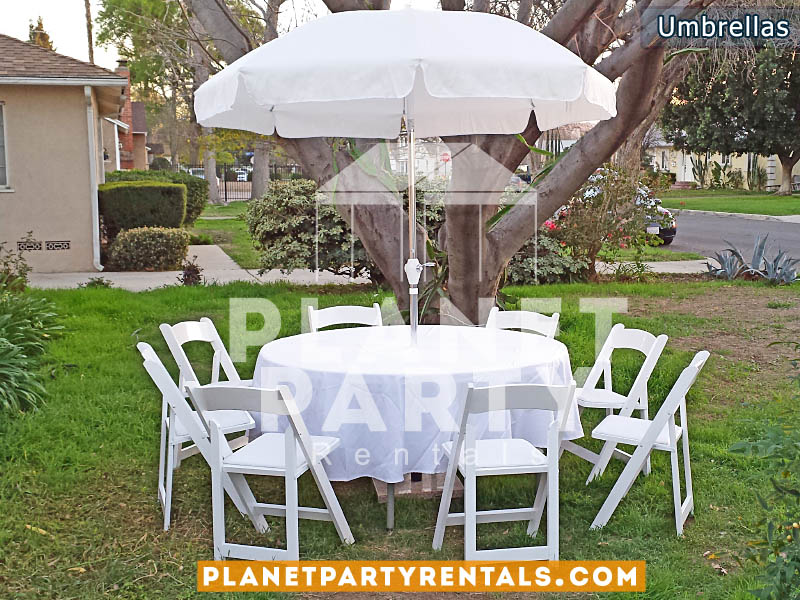 Outdoor White Patio Umbrella with Stand and Round Table with White Tablecloth and White Wooden Chairs