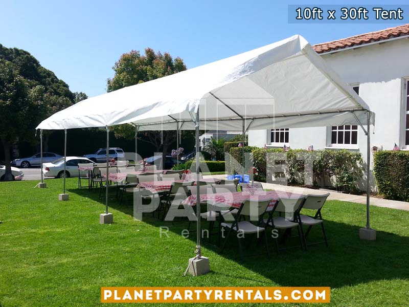 10x30 Tent with Rectangular Tables and Plastic White Chairs setup on grass