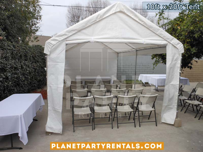 10x20 White Party Tent with white Sidepanels and Plastic White Chairs setup on cement