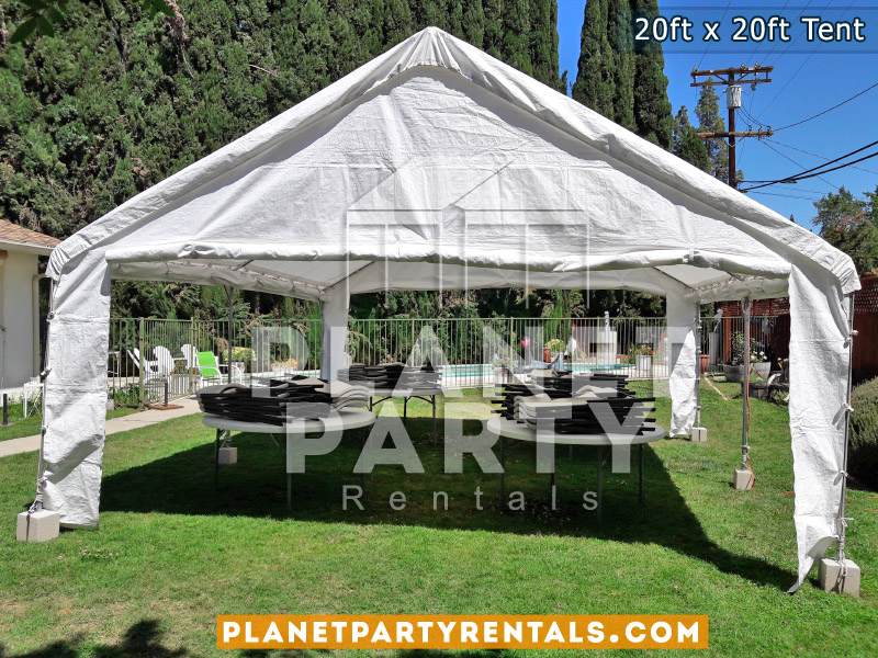 20 x 20 Tent with Round Tables and Plastic Chairs on Grass